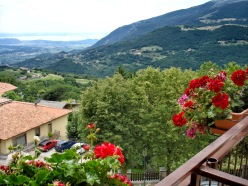 """The view from my hotel in the village of Spiazzi - """"Hotel Posta"""". The surrounding mountains and Lake Garda are visible in the distance."""