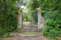"A ""Secret Gate"" guarded by two dragons, Villa Garzoni gardens, Italy."